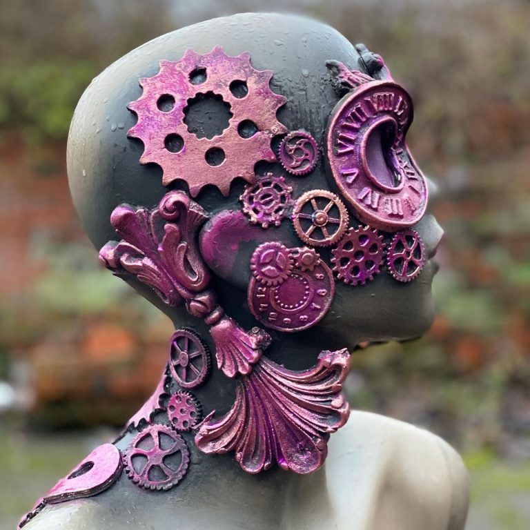 Mannequin head with steampunk WoodUbend mouldings stuck it it and painted pink