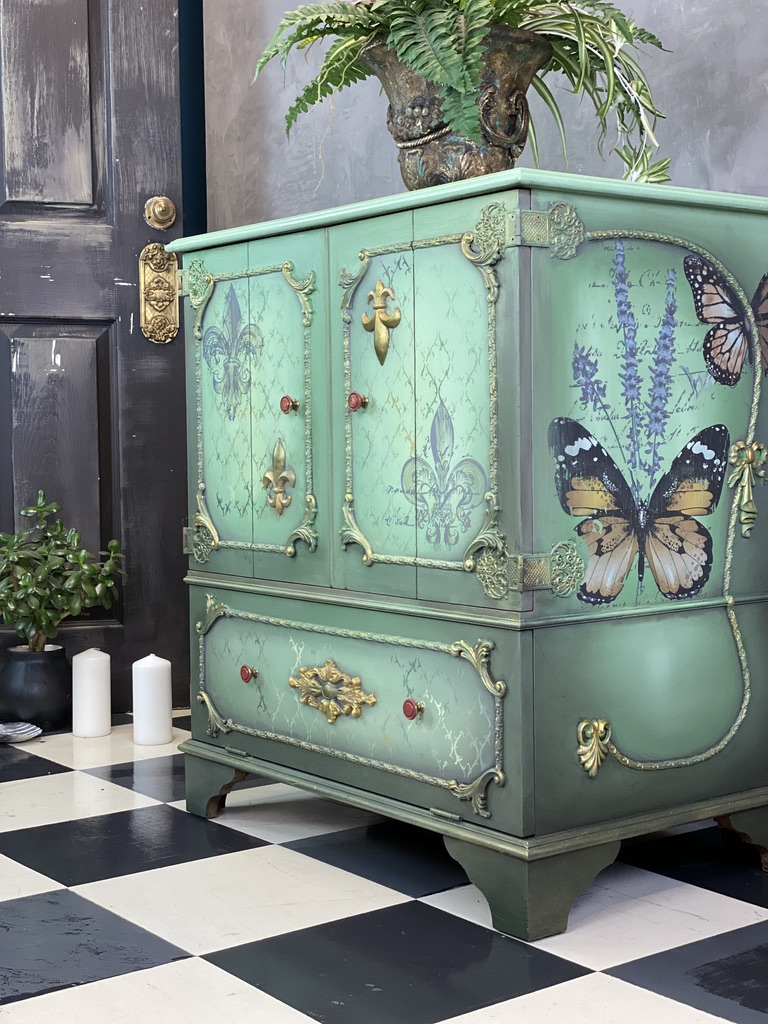 Side view of the cabinet showing butterfly and lavender transfers