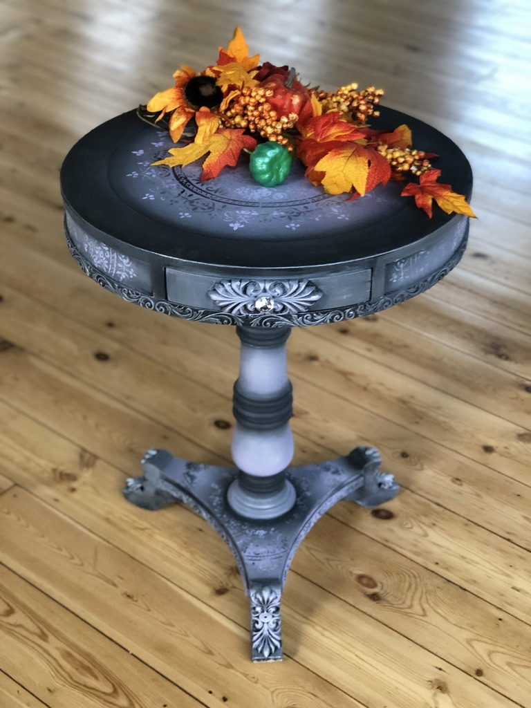 An upcycled table top staged with autumn dressing, Dixie Belle and WoodUbend mouldings were used on this piece