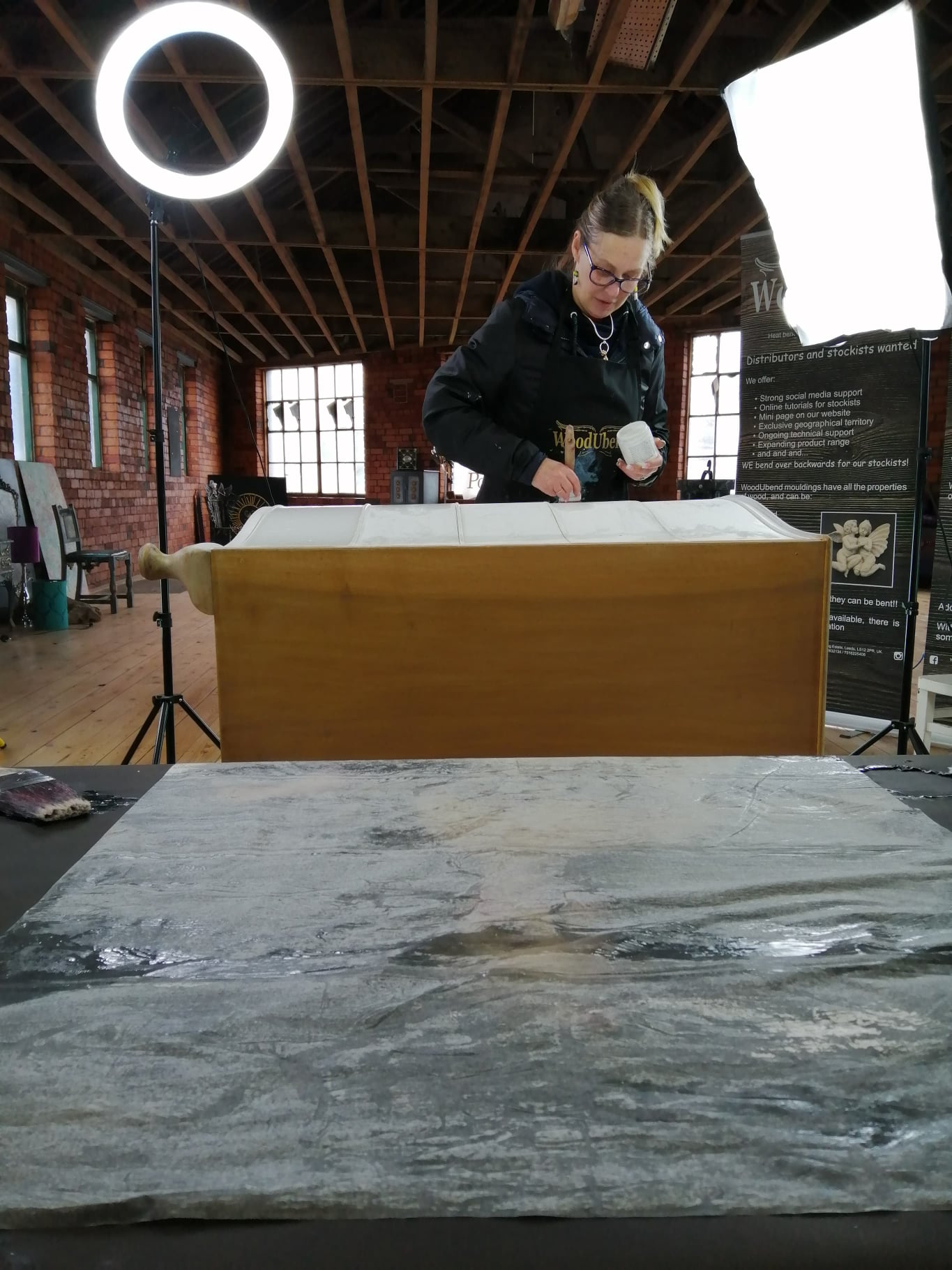 Hope drying off in the foreground as SollyJo repaints her furniture upcycling project.