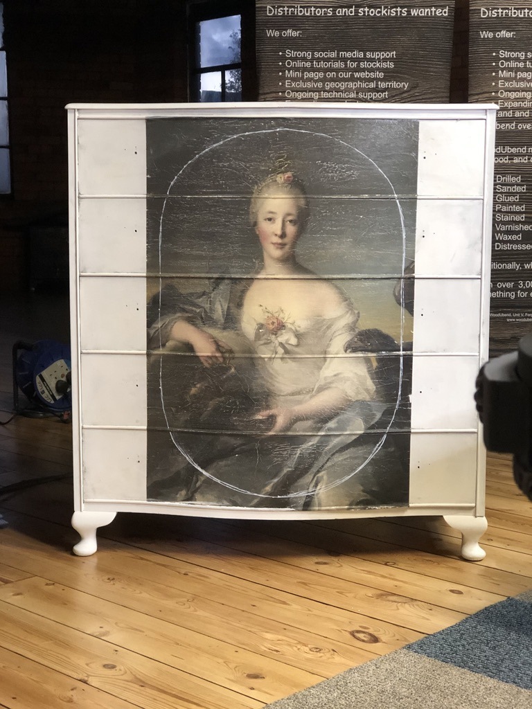 The first stage of the ambitious furniture upcycling project hope. The decoupage is stuck down and a chalk guide drawn where the mouldings will be placed.