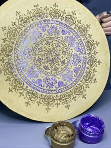 Posh Chalk pastes, violet metallic and vintage gold textured used with a stencil. The opened pastes can be seen in the foreground