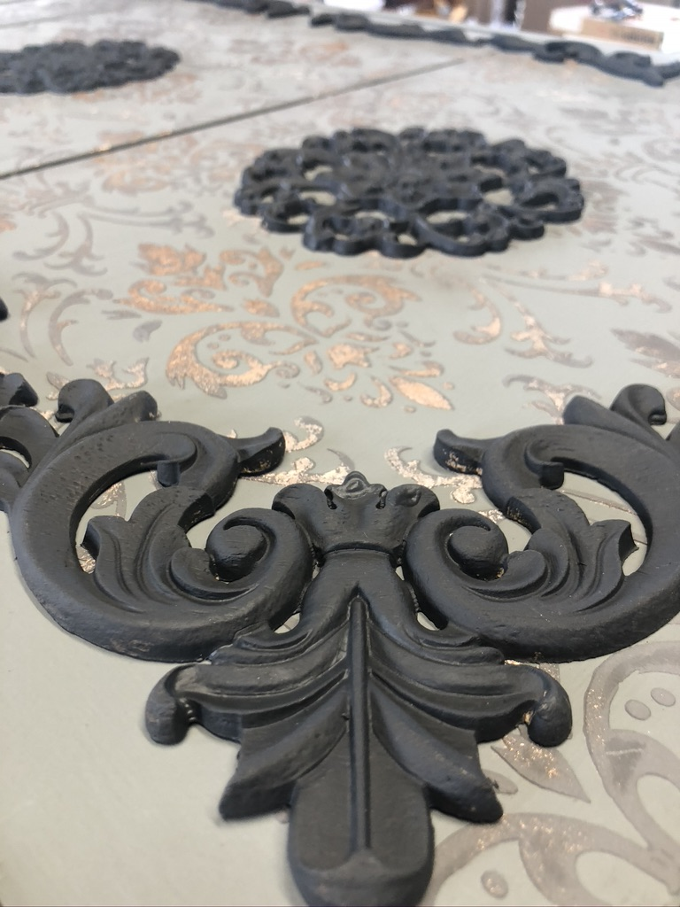 Close up of the 2093 corner moulding placed on over the raised stencilling. In the background there are the floral centrepiece mouldings