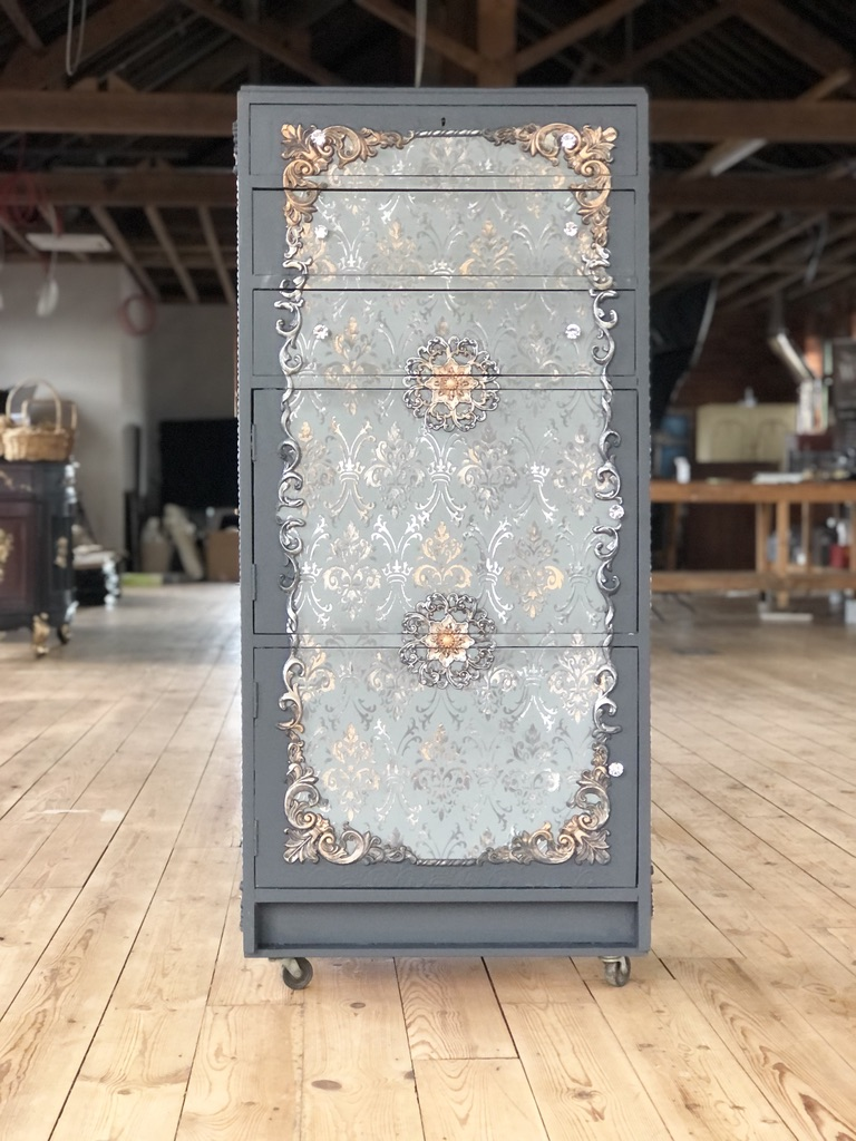 A mid shot of the completed furniture art project. The diamanté handles are sparkling in the light