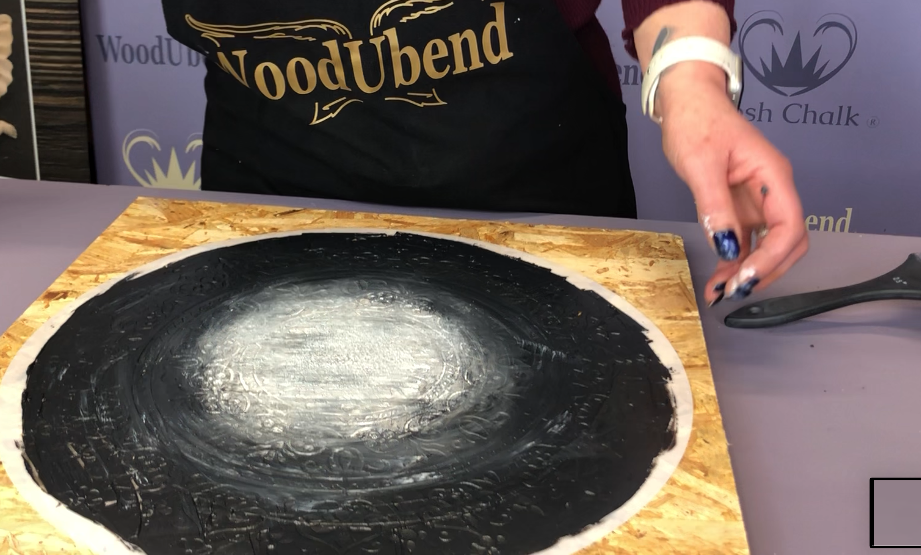 Black and white paste on a stencil prior to the reveal