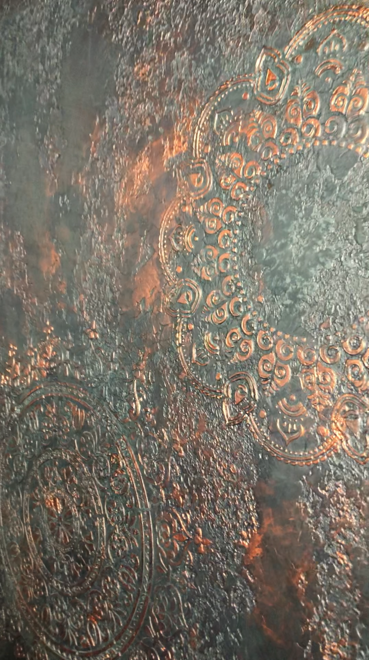 Copper pigments highlighting the blue mandala raised stencilling