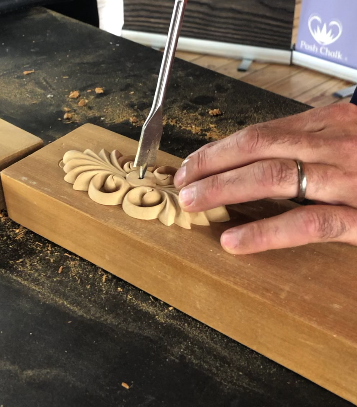 X1008 WoodUbend mouldings being drilled with a flat drill bit on a block of wood as a part of a crafting project.