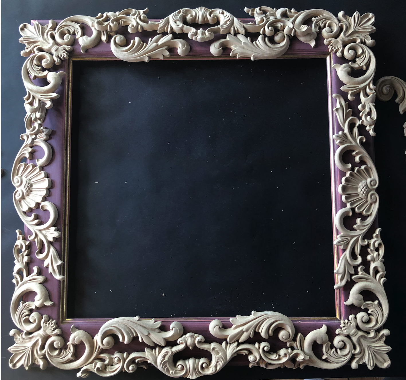 A Trash to treasure piece, a mirror frame with the glass taken out and WoodUbend mouldings placed all over it.