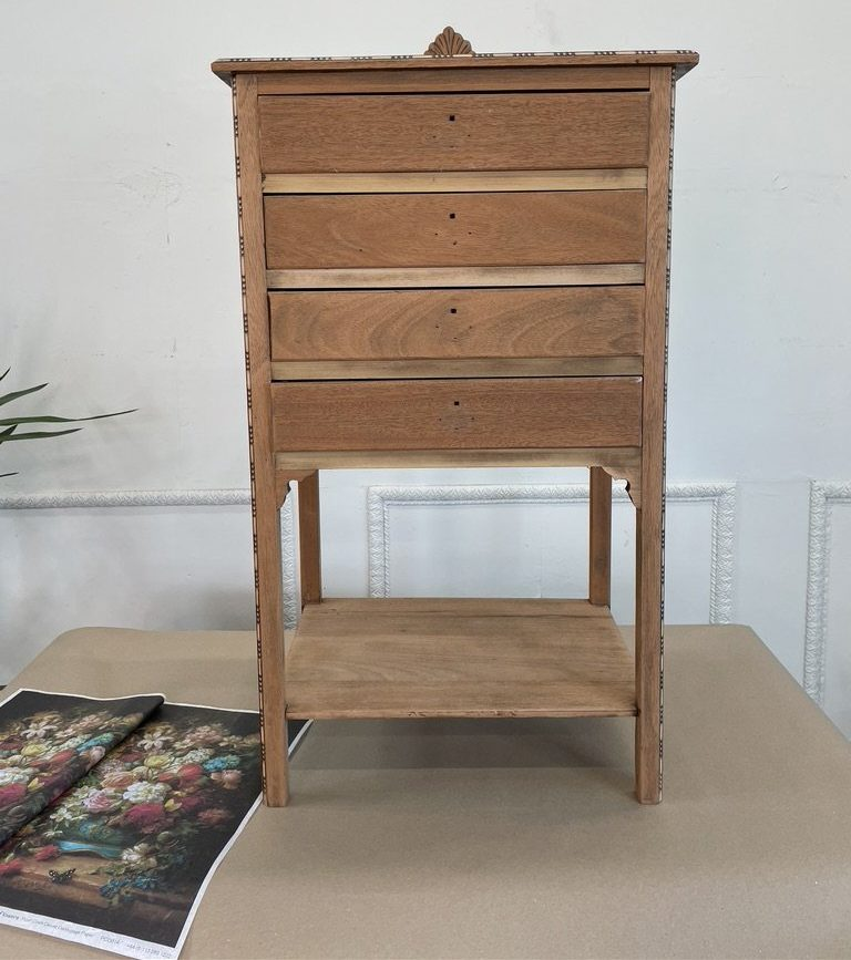 A brown set of drawers against a white background. Posh Chalk Deluxe Decoupage can be seen in the bottom left
