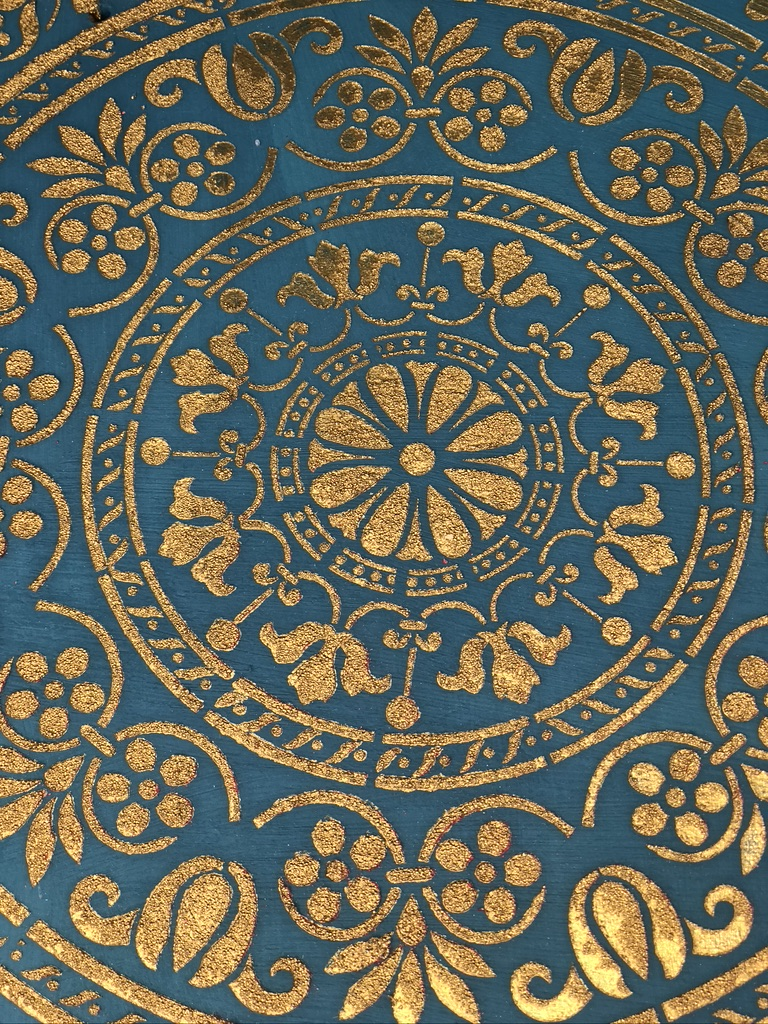 Gold on blue stencilling in a mandala style