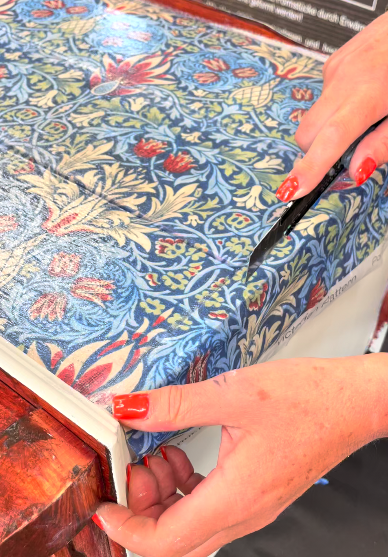 Posh Chalk Deluxe Decoupage being sliced with a craft knife