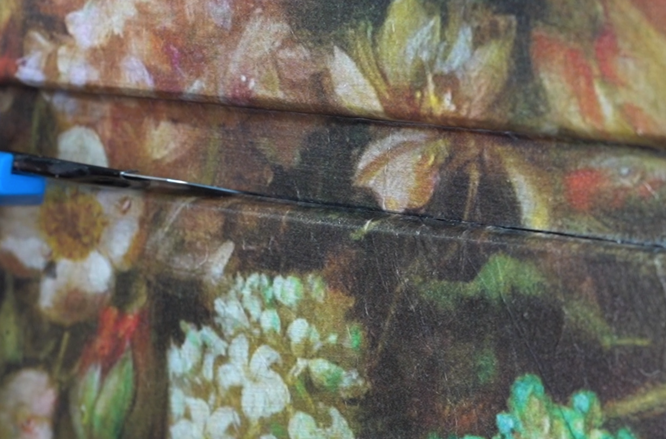 Floral Decoupage being sliced with a blue Stanley Knife