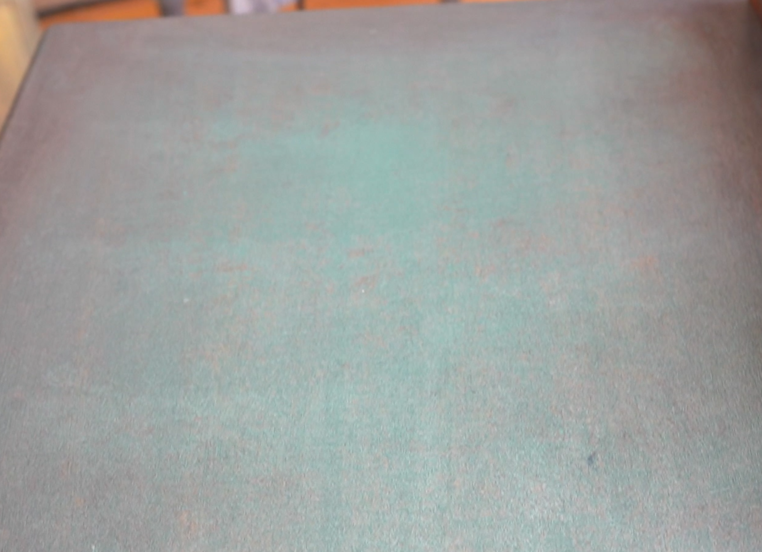 the top of a set of drawers washed with green posh chalk paste