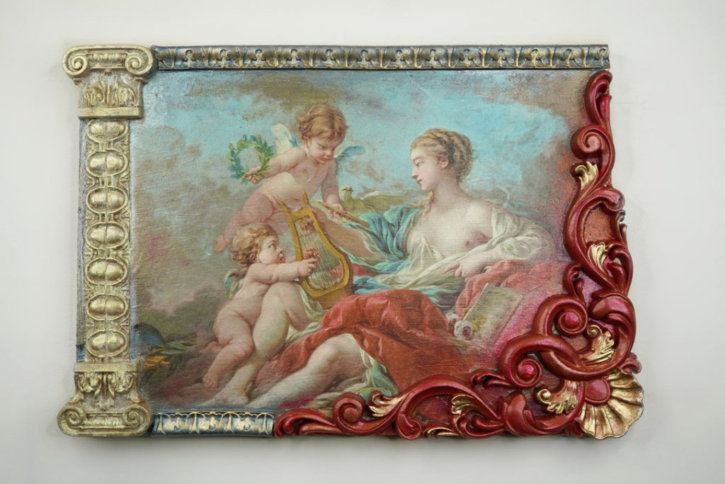 An image showing how effective DIY crafts are with WoodUbend and Posh Chalk. Decoupage in the middle features cherubs whilst the woodubend mouldings around the outside feature red and gold accents.