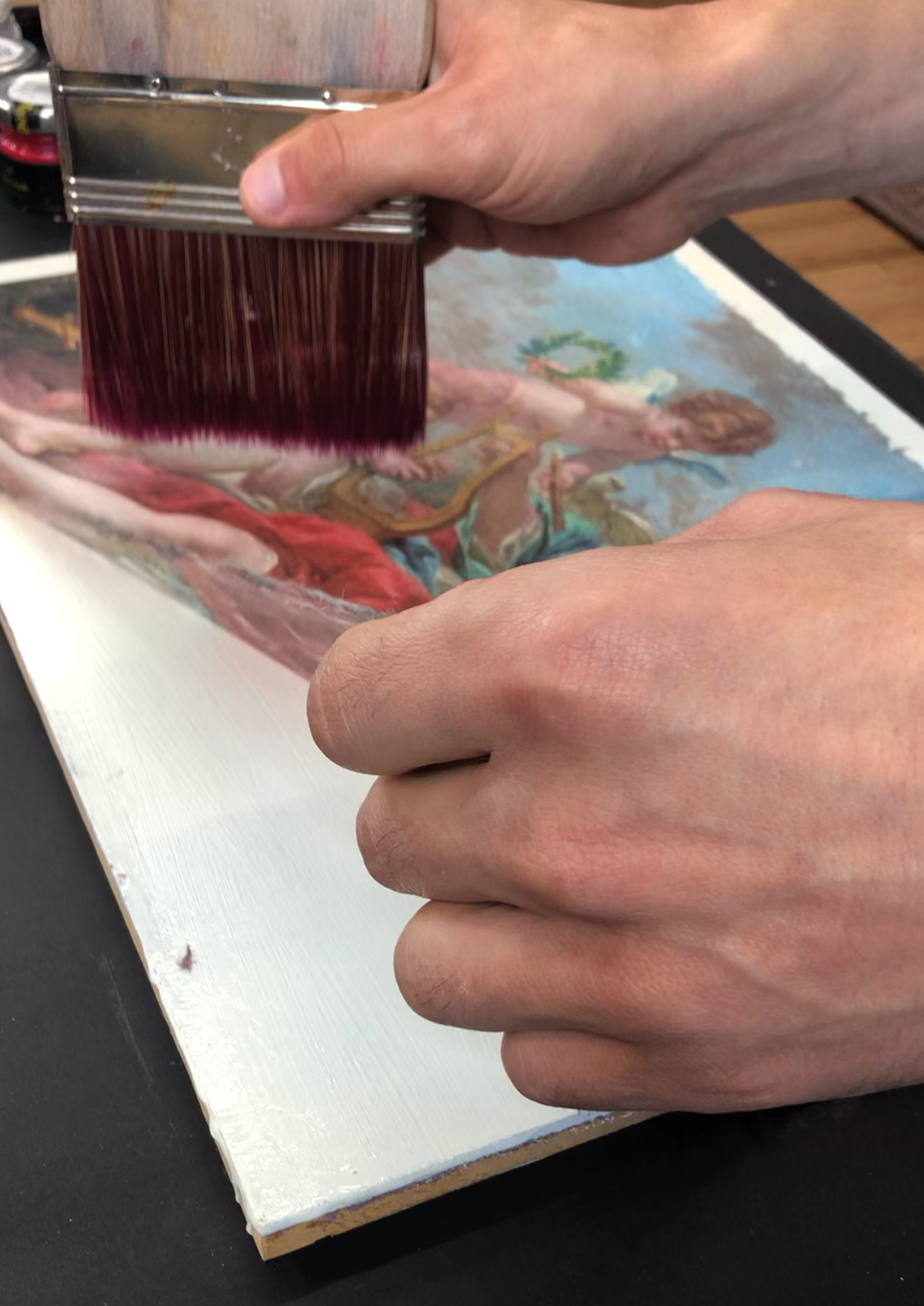 Posh cgal decoupage being applied on a piece of MDF wood